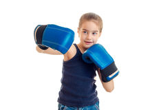 Young sports girl practicing boxing in blue gloves Stock Photo
