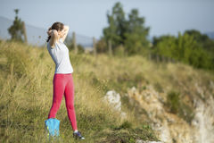 Young sports girl standing outdoors. Royalty Free Stock Photo