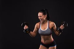 Young sports-looking nice lady with dark hair Royalty Free Stock Photo