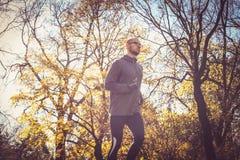 Young sports man running trough nature. Stock Photos