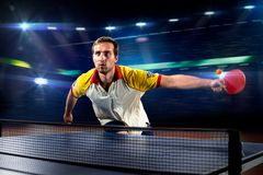 Young sports man tennis player playing on black Royalty Free Stock Photography