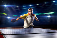Young sports man tennis player playing on black Royalty Free Stock Photos