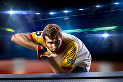 Young sports man tennis player playing on black Stock Photos