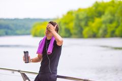 Young sports man with towel and bottle of water Royalty Free Stock Photography