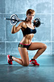 Young sports woman. With barbell Stock Photography