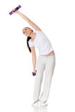 Young sports woman with dumbbells. Stock Photography