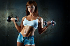 Young sports woman. With dumbbells Royalty Free Stock Image
