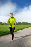 Young sports woman enjoys fitness and bright sunshine Royalty Free Stock Images