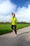 Young sports woman enjoys fitness and bright sunshine Stock Images
