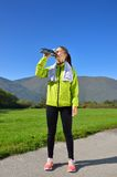Young sports woman enjoys fitness and bright sunshine Stock Photography