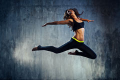 Young sports woman jumping Royalty Free Stock Image