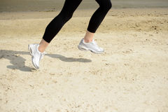 Young Sports Woman Running on the Beach Stock Images