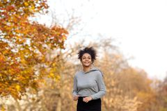 Young sports woman running in the park Royalty Free Stock Photos