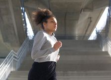 Young sports woman running in urban environment Stock Image