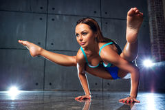 Young sports woman. Young slim sports woman stretching in yoga pose Royalty Free Stock Image