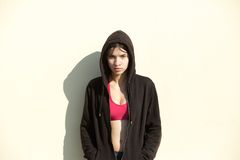 Young sports woman standing outdoors with black sweatshirt Royalty Free Stock Image