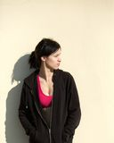 Young sports woman standing outside with black sweatshirt Stock Image