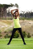 Young sports woman stretching arms Stock Images