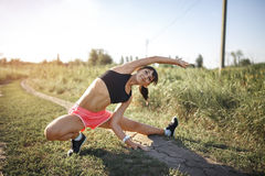 Young sports woman stretching and preparing to run. Stock Photography