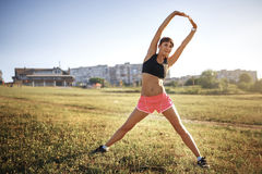 Young sports woman stretching and preparing to run. Stock Image