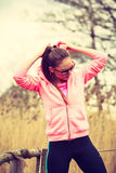 Young sports woman taking break after a run. Stock Images