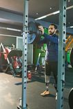Young sportsman training in gym stock image