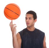 Young Sportsman Balances Ball On A Finger. Over White Background Stock Photography