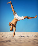 Young sportsman on beach Stock Images