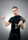 Young sportsman with a clenched fist Stock Photography