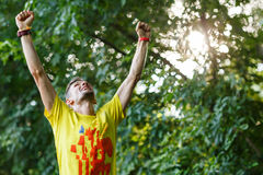 Young sportsman doing exercise in summer park. Young sportsman doing exercise in morning summer park Stock Photography