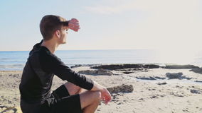 Young sportsman enjoying the sea and sun view on the beach slow motion stock video footage