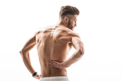 Young sportsman feels terrible backache Stock Photos