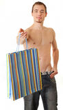 Young sportsman with gift bags Royalty Free Stock Photos