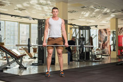 Young sportsman in gym. Stock Photo