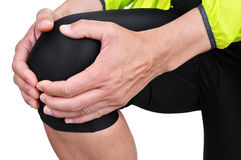 Young sportsman with knee pain Stock Photos