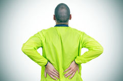 Young sportsman with low back pain Stock Photography
