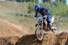 Motocross high jump. The young sportsman on a motorcycle jump Stock Image