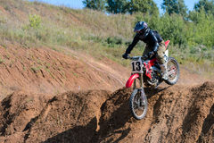 Motocross high jump. The young sportsman on a motorcycle jump Royalty Free Stock Images