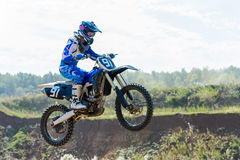 Motocross high jump. The young sportsman on a motorcycle jump Stock Images