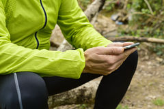 Young sportsman outdoors using his smartphone Stock Photo
