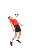 Young sportsman in red jersey playing football Stock Photography