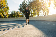 Young sportsman running to finish, free space Royalty Free Stock Image