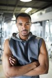 Young sportsman. Strong young African-american sportsman crossing arms on chest while standing in front of camera stock photo