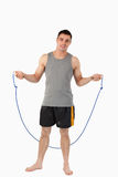 Young sportsman about to start rope jumping. Against a white background Stock Photography