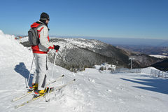 Young sportsman at the top of the ski slope Stock Photography
