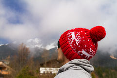 Young sportsman or traveler in winter hat looking on horizon. Mo. Untain range on background. Horizontal. Travel Concept Stock Image
