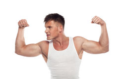 Young sportsmen demonstrates biceps Royalty Free Stock Photos