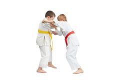Young sportsmens do capture of karategi Stock Photos