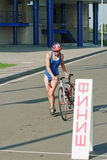 The young sportswoman finish  a bicycle stage Royalty Free Stock Photo