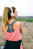 Young sportswoman in front of the way to go. Back view of young sportswoman in front of the way to go Stock Photos
